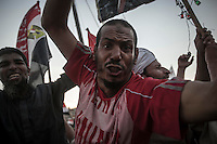 In this Friday, Aug. 09, 2013 photo, a supporter of the ousted president Mohammed Morsi demonstrates in the streets nearby Al-Raba'a Alawya mosque in the Nasr district of Cairo. (Photo/Narciso Contreras).