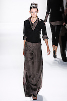 Model walks runway an EBONY SILK + CASHAERE HANDLOOMED PULLOVER W/ ATTACHED SILK .MOUSSELINE LINEN SHIRT AND DESERT SILK GAZA LINEN HIP-HUGGING FULL TROUSERS W/ SIDE PLEATS by Zang Toi, for the Zang Toi Spring 2012 My Dream Of North Africa Collection, during Mercedes-Benz Fashion Week Spring 2012.