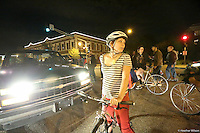 Young people on bikes shut down traffic on Grand St in Saint Louis as protests expand throughout the city in response to an off-duty police officer shooting another young man (Vonderrit Meyers). October 8, 2014