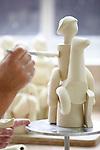 Proceso de creacion de ceramica en la fabrica de Sargadelos en Cervo, Lugo. Pegado de las piezas de una figura.