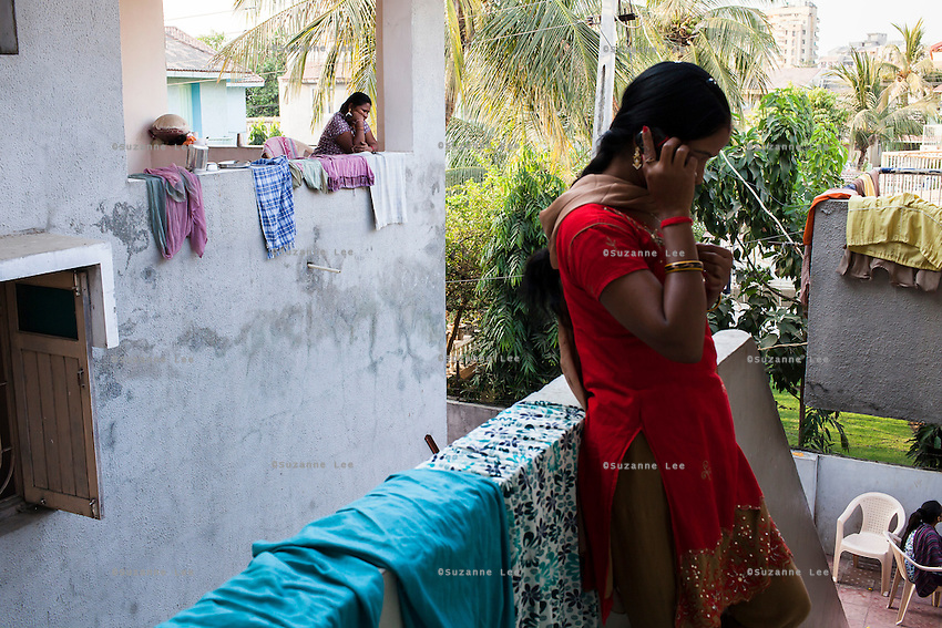 Surrogates spend a lot of time chatting on their mobile phones with family and friends, as they spend the entire pregnancy mostly shrouded in secrecy, in the surrogate's house in Anand, Gujarat, India on 11th December 2012. Photo by Suzanne Lee / Marie-Claire France