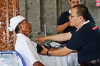 A patient undergoing tests prior to surgery to remove cataracts in his eyes, Bali, Indonesia.