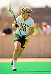 25 April 2009: University of Vermont Catamount attackman Kaitlyn Johnson, a Junior from Meriden, NH, in action against the Stony Brook University Seawolves at Moulton Winder Field in Burlington, Vermont. The Lady Cats defeated the visiting Seawolves 19-11 on Seniors Day, Vermont's last home game of the 2009 season. Mandatory Photo Credit: Ed Wolfstein Photo