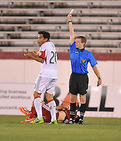 Carlos Ruiz (20) of D.C. United gets a red card from referee Eric Weisbrod  in the 24th minute of the overtime after giving a hard tackle on Mike Callahan of the Richmond Kickers. D.C. United defeated the Richmond Kicker in penalty kicks 4-2 after finished 0-0 in overtime to advance to the next game in the Lamar Hunt U.S. Open Cup, at City Stadium, Tuesday May 28 , 2013.