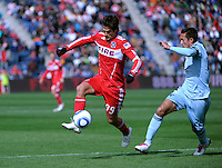 Chicago Fire forward Diego Chaves (99) controls the ball in front of Sporting KC midfielder Davy Arnaud (22).  The Chicago Fire defeated Sporting KC 3-2 at Toyota Park in Bridgeview, IL on March 27, 2011.