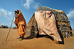 Fatima Hassan Mohammed, an 80-year old Somali woman who fled drought and war in her country, rests outside her makeshift hut in the bula baqti - the place of the carcasses - section of the Dadaab refugee camp in northeastern Kanya. She arrived five months ago, and some other family members who arrived in the last week helped her make this hut, an improved model over what she had before. Tens of thousands of newly arrived Somalis have swelled the population of what was already the world's largest refugee camp.
