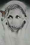 Conceptual image of female face with butterfly