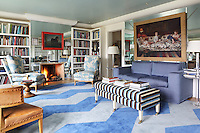 A blue and grey chevron carpet designed by Peter Twining is the focus of the mirror-panelled living room