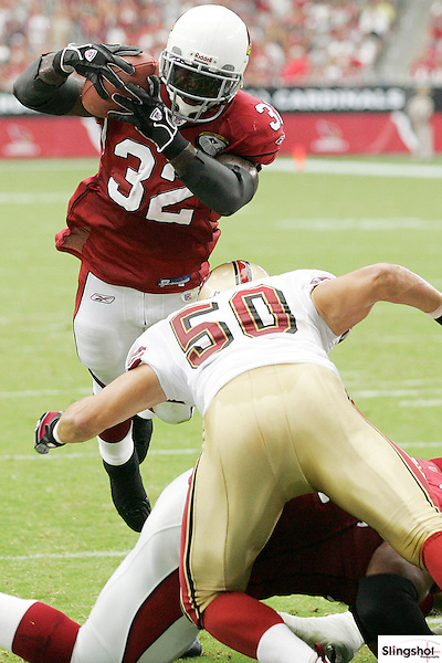 Arizona Cardinals running back Edgerrin James goes over the top for a touchdown against the San Francisco 49ers at Cardinals Stadium in Glendale, Arizona September 10, 2006...