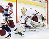 Cam Atkinson (BC - 13) helps clear the puck in front of John Muse (BC - 1) - The Boston College Eagles defeated the visiting University of Maine Black Bears 4-0 on Friday, November 19, 2010, at Conte Forum in Chestnut Hill, Massachusetts.