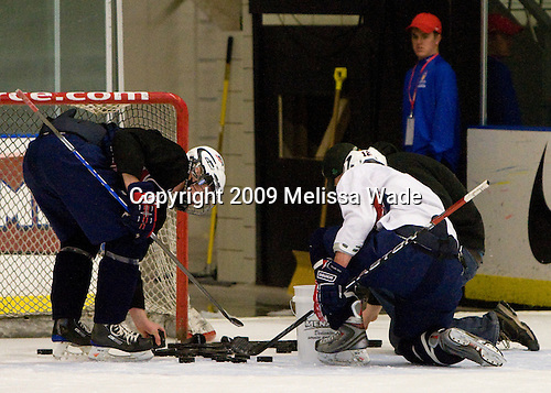 Jon Merrill (US - 6), Chris Brown (US - 12) - The US practiced the morning of Sunday, April 19, 2009, prior to their gold medal game against Russia in the 2009 World Under 18 Championship at the Urban Plains Center in Fargo, North Dakota.