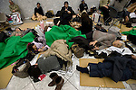 People affected by the magnitude 8.8 quake that struck Japan take refuge in a shelter inside the Tokyo metropolitan building in Tokyo, Japan on 11 March, 2011. Photographer: Robert Gilhooly