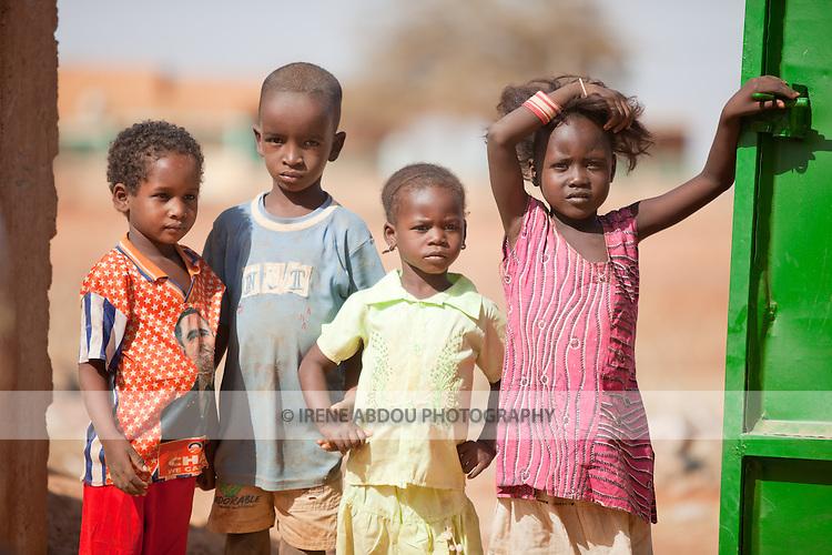 Fulani children in the town of Djibo in northern Burkina Faso.  One girl sports a Barack Obama t-shirt.