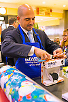 Dec. 12, 2012 - Garden City, New York, U.S. - SAL DOSSENA, Student Services Director of the Merrick School District, helps the Merrick Kiwanis Club, a community service group, wrap gifts at Roosevelt Field mall in Long Island, to raise funds to use for charity, during the busy winter holiday shopping season. Some ways Kiwanis helps the community are by providing food, clothing, and school supplies to those in need, sending children to Kamp Kiwanis, providing scholarships and hosting a Harvest Ball for senior citizens.