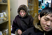 Reindeer herders Simyon and Vanya travel hours by sled from their tent in the tundra to buy supplies at the village shop in Sovetsky.<br /> Nomadic people like them have a mutually cautious relationship with the Russians who live in the Far North.<br /> Vorkuta is a coal mining and former Gulag town 1,200 miles north east of Moscow, beyond the Arctic Circle, where temperatures in winter drop to -50C. <br /> Here, whole villages are being slowly deserted and reclaimed by snow, while the financial crisis is squeezing coal mining companies that already struggle to find workers.<br /> Moscow says its Far North is a strategic region, targeting huge investment to exploit its oil and gas resources. But there is a paradox: the Far North is actually dying. Every year thousands of people from towns and cities in the Russian Arctic are fleeing south. The system of subsidies that propped up Siberia and the Arctic in the Soviet times has crumbled. Now there&rsquo;s no advantage to living in the Far North - salaries are no higher than in central Russia and prices for goods are higher.