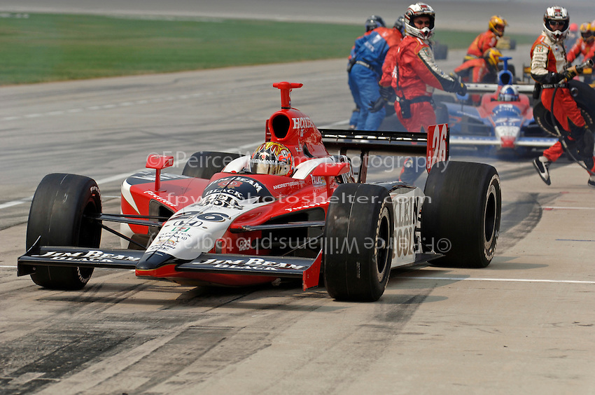 11 September, 2005, Joliet,IL,USA<br /> Dan Wheldon makes a pit stop.<br /> Copyright&copy;F.Peirce Williams 2005