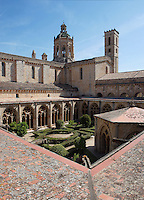 High angle view of the cloister of Monestir de Santes Creus, Aiguamurcia, Catalonia, Spain, pictured on May 21, 2006, in the morning. The 13th century cloister is seen from the upper gallery with the abbey's church in the background. The Romanesque lavabo in the patio dates back to the 12th century. The Cistercian Reial Monestir Santa Maria de Santes Creus and its church were built between 1174 and 1225. Following strict Cistercian rule, the Romanesque complex originally featured no architectural embellishments with the exception of ornamented capitals and crenellations on the rooflines. In the 13th century parts of the abbey and the cloister were converted in Gothic style by James II of Aragon who also added the dome to the church. Picture by Manuel Cohen.