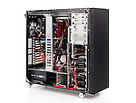 PC computer open ATX case with motherboard and other hardware installed isolated on white background