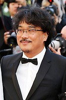 """Bong Joon-Ho at the """"Okja"""" premiere during the 70th Cannes Film Festival at the Palais des Festivals on May 19, 2017 in Cannes, France. (c) John Rasimus /MediaPunch ***FRANCE, SWEDEN, NORWAY, DENARK, FINLAND, USA, CZECH REPUBLIC, SOUTH AMERICA ONLY***"""