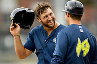Left fielder Tim Tebow (15) of the Columbia Fireflies talks with manager Jose Leger in a game against the Lexington Legends on Sunday, April 23, 2017, at Spirit Communications Park in Columbia, South Carolina. Lexington won, 4-2. (Tom Priddy/Four Seam Images)