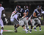 Ole Miss' Patrick Junen (77) blocks vs. Alabama at Vaught-Hemingway Stadium in Oxford, Miss. on Saturday, October 14, 2011. Alabama won 52-7.