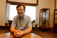 Takashi Sugiyama, staff of the Japan Folk Crafts Museum (Mingeikan), Tokyo, Japan, September 9, 2012.