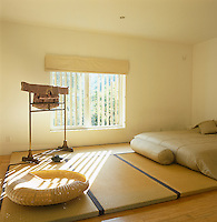 A low bed in the main bedroom has been placed on tatami matting