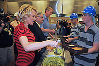 Phoenix, Arizona -- Actress Pamela Anderson helps to serve a meal to a jail inmate. Anderson visited the Lower Buckeye County Jail in Phoenix, Arizona to promote all-vegetarian meals for inmates. Anderson visited the detention facilities as a spokesperson for People for the Ethical Treatment of Animals (PETA). The actress was given a tour of the facilities by Maricopa County Sheriff Joe Arpaio.  Anderson was accompanied by PETA Senior Vice President Dan Mathews. Photo by Eduardo Barraza © 2015