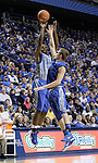 Darius Miller shoots a three in the Blue-White Scrimmage at Rupp Arena Wednesday night, October 26, 2011.  Photo by Scott Hannigan