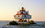 "Thomas Point Lighthouse near  the mouth of the South River on Chesapeake Bay.  Petty Office Remaly was the last USCG ""keeper"" stationed at the lighthouse.   It was automated and the 4th order Fresnel Lens removed in 1986.  It is now automated and the Fresnel lens was replaced with a plastic modern beacon."