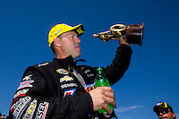 Jul. 27, 2014; Sonoma, CA, USA; NHRA pro stock driver Jason Line celebrates after winning the Sonoma Nationals at Sonoma Raceway. Mandatory Credit: Mark J. Rebilas-