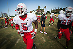 FRESNO, CA - AUGUST 11, 2014:   Fresno State safety Dalen Jones, left, takes the field during morning practice. CREDIT: Max Whittaker for The New York Times