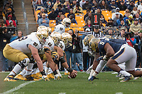 The Notre Dame offensive line lines up against the Pitt defensive line at the line of scrimmage.  The Notre Dame Fighting Irish football team defeated the Pitt Panthers 42-30 on Saturday, November 7, 2015 at Heinz Field, Pittsburgh, Pennsylvania.