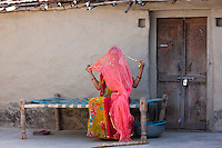 Young Indian Hindu girl age 20 making bridal veil at home in Tarpal in Pali District of Rajasthan, Western India