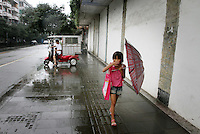 "A young girl in the town of Dujiangyan, famed for its ancient irrigation System. The system is regarded as an ""ancient Chinese engineering marvel."" By naturally channeling water from the Min River during times of flood, the irrigation system served to protect the local area from flooding and provide water to the Chengdu basin. Sichuan Province. 2010"