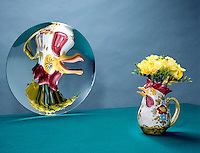VASE REFLECTED IN CONCAVE (PARABOLIC) MIRROR (1 of 2)<br /> Real, Inverted &amp; Enlarged Image of Rooster Jug<br /> An object placed between the center of curvature of the mirror &amp; the focal point forms a real, inverted &amp; enlarged  image.  A concave mirror can form both real and virtual images.
