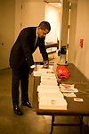 "Senator Barack Obama, Democratic presidential candidate, signs books backstage before a campaign speech at the ""Key Arena"" in the Seattle Center, Seattle, Washington, February 7, 2008."