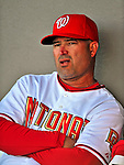 18 March 2009: Washington Nationals' Manager Manny Acta sits in the dugout prior to a Spring Training game against the Florida Marlins at Space Coast Stadium in Viera, Florida. The Marlins defeated the Nationals 7-5 in the Grapefruit League matchup. Mandatory Photo Credit: Ed Wolfstein Photo