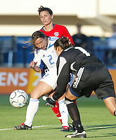 11 August 2004:  Greece goalkeeper Maria Giatrakis made a save from Mia Hamm's kick at Pankritio Stadium in Heraklio, Greece.. USA defeated Greece, 3-0. Credit: Michael Pimentel / ISI