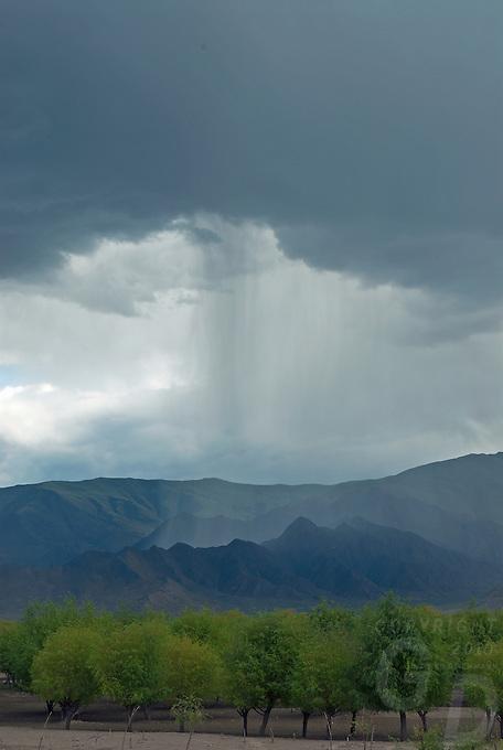 A dramatic rainstorm north of Lhasa on the Tibetan Plateau. Tibet, China.