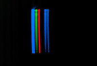SPECTRUM ANALYSIS: EMISSION (BRIGHT LINE) SPECTRA<br /> Xenon (Xe) Noble Gas<br /> Electrical discharge passes through the spectrum tube, which is filled with gas, causing electrons in the gas to be excited.  As the electrons relax, they emit light - a characteristic color for each gas.