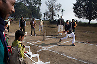 Minister of Legislative Assembly, Ritesh Pandey, 30, takes a bat as he inaugurates a cricket tournament for 20-25 year olds in Saharanpur Umran, Ambedkar Nagar, Uttar Pradesh, India, on 21st January, 2012. Returning 1.5 years ago after almost 10 years abroad, Pandey is contesting on behalf of the Bahujan Samaj Party (BSP), a party that is based on its appeal to Dalit (the lowest Hindu caste) voters. Party leader Mayawati, herself a Dalit, has recently been giving out more tickets to muslims and high caste candidates in an attempt to woo a larger spectrum of voters in Uttar Pradesh, a Bellwether state. Photo by Suzanne Lee for The National (online byline: Photo by Szu for The National)
