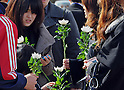March 11, 2012, Rikuzentakata, Japan - People offer prayers during a religious service  in  Rikuzentakata, Iwate Prefecture, some 402 km northeast of Tokyo, on Sunday, March 11, 2012..Memorial ceremonies were held throughout Japan to mark the one year anniversary of the massive earthquake and tsunami that struck the country?fs northeastern region, killing just over 19,000 people and unleashing the world?fs worst nuclear crisis in a quarter century. The quake was the strongest recorded in the nation?fs history, and set off a tsunami that towered more than 65 feet in some spots along the northeastern coast, destroying thousands of homes and wreaking widespread destruction. (Photo by Natsuki Sakai/AFLO) AYF -mis-