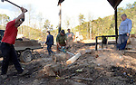(lt to rt) Joe Moore, Phillip Bailey, Wayne Stewart, and Shannon Lovely chop, saw, and carry wood to the truck as Clarence Bailey supervises and discusses tomorrow's duties. Photo by Amy Gaskin