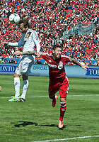 30 March 2013: Los Angeles Galaxy forward Mike Magee #18 and Toronto FC defender Danny Califf #3 in action during an MLS game between the LA Galaxy and Toronto FC at BMO Field in Toronto, Ontario Canada..The game ended in a 2-2 draw..