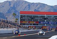 Feb 25, 2017; Chandler, AZ, USA; NHRA pro stock driver Vincent Nobile (left) races alongside Tanner Gray during qualifying for the Arizona Nationals at Wild Horse Pass Motorsports Park. Mandatory Credit: Mark J. Rebilas-USA TODAY Sports