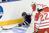 Kevin Goumas (UNH - 27), Vincent LoVerde (Miami - 14) - The University of New Hampshire Wildcats defeated the Miami University RedHawks 3-1 (EN) in their NCAA Northeast Regional Semi-Final on Saturday, March 26, 2011, at Verizon Wireless Arena in Manchester, New Hampshire.