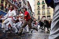 The Running of the Bulls (encierro de los toros) during the San Fermín festival in Pamplona, Spain, 10 July 2005.