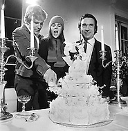 "January 1970, New York City. American actor Ryan O'Neal, American actress Ali MacGraw, and Canadian director Arthur Hiller cutting a wedding cake on the movie set of the 1970 American film ""Love Story"". O'Neal starred as Oliver Barrett IV and MacGraw as Jennifer Cavilerri in the romance directed by Hiller."