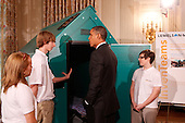 United States President Barack Obama discusses a lightweight portable disaster relief shelter designed by Jessica D'Esposito (R), Colton Newton and Anna Woolery (L) from Petersburg, Indiana representing the Pike Central High School InvenTeam, while touring student science fair projects on exhibt at the White House in Washington, D.C. on February 7, 2012.  Obama hosted the second White House Science Fair celebrating the student winners of science, technology, engineering and math (STEM) competitions from across the country. .Credit: Molly Riley / Pool via CNP